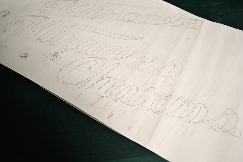 Pencil drawing of Miracles & Charms lettering